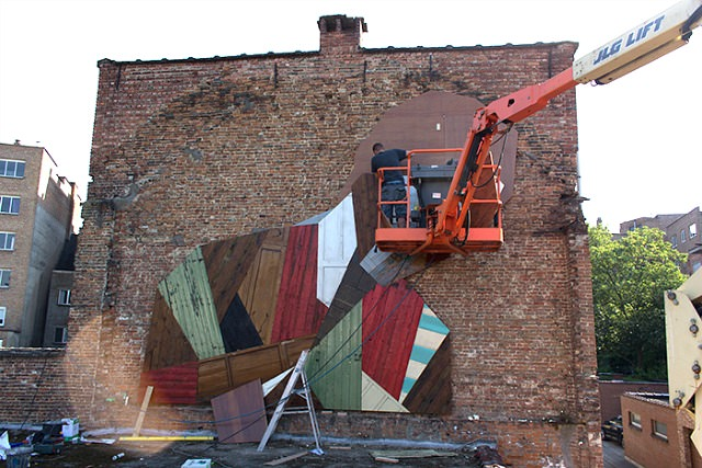 Mural Sculpture Made From Discarded Wooden Planks and Doors Art + Graphics Sustainability